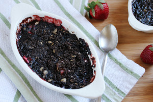 Rich chocolate topping over fresh strawberries make this decadent Strawberry Brownie Crumble a must try for the true brownie lover!