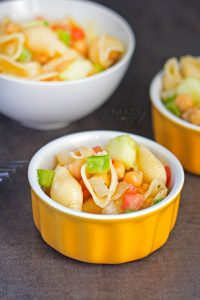 This light and tasty Chickpea Pasta Salad combines chickpeas, pasta, green peppers, cucumbers, tomatoes and onions; it makes a great side dish to any meal!