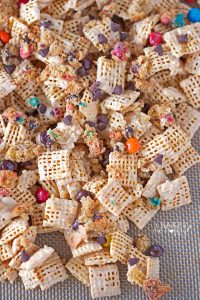 Sweet and crunchy Monster Cookie Snack Mix is loaded with peanut buttery flavor, monster cookie crumbs, chocolate chips and M&M candies.