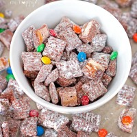 Deliciously addictive Halloween Candy Muddy Buddies comes together in minutes and is a great way to use up all that leftover Halloween candy!