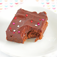 soft fudge brownies are topped with a thick layer of rich chocolate ganache