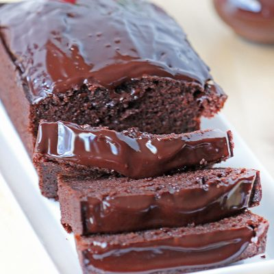 Chocolate Pound Cake sliced and topped with chocolate ganache
