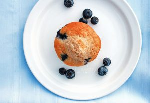 Lightly sweet delicious Fresh Blueberry Muffins are chock-full of fresh berries and made healthier with whole wheat flour.