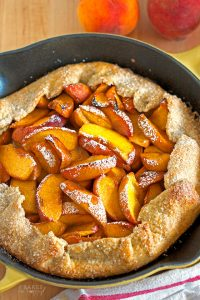 Juicy fresh peaches are baked in a delicious, flaky crust for this super easy Peach Skillet Galette that is baked in your favorite cast iron skillet.