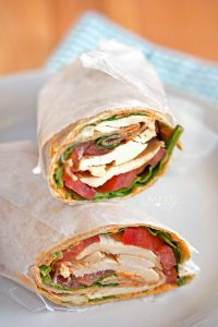 A quick healthy lunch is just minutes away with these Roasted Pepper Hummus Chicken Wraps, loaded with spinach, tomatoes, roasted pepper hummus and chicken.
