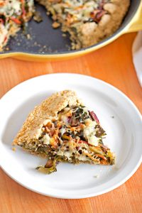 Gluten Free Swiss Chard & Mushroom Galette - tender, flaky crust filled with Swiss Chard, Portobello mushrooms, shredded carrots, white cheddar cheese.