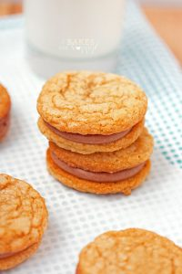 Chewy peanut butter cookies, sandwiched with a rich, smooth chocolate icing make these Peanut Butter Chocolate Sandwich Cookies a great after school snack!